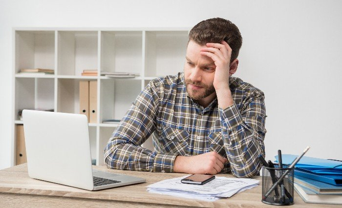 Frustrated Business owner sitting at desk