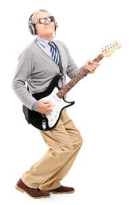 Older man with electric guitar