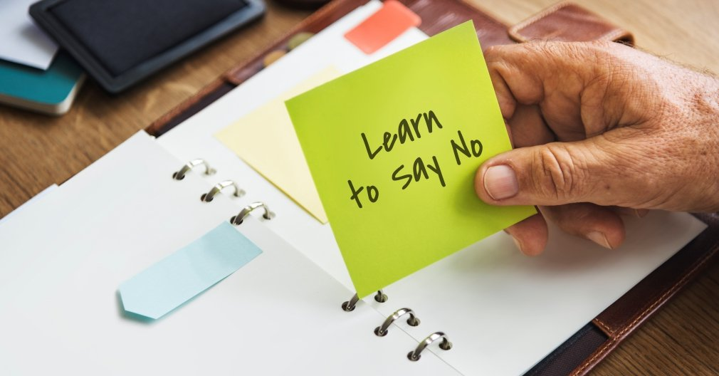 a day planner with the reminder to learn how to say no