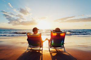 romantic couple enjoying beach at sunset